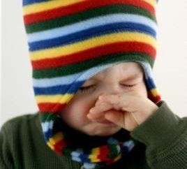 Gruby smark u dziecka niż leczyć? Komorowski: katar u dziecka