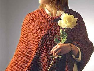 poncho tricotée a parlé: beau, chaleureux, élégant