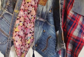 couverture de patchwork de vieux jeans avec ses mains