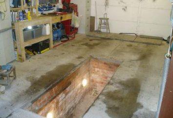 pozzetto di ispezione in garage con le mani