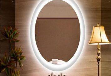 Miroir lumineux dans la salle de bain avec leurs mains. miroirs lumineux photo