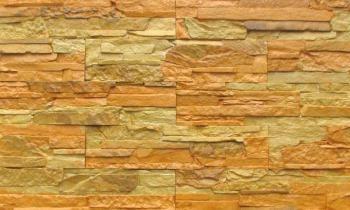 Steinimitat. Fassadenplatten unter dem Stein. Tiling Stein