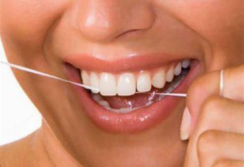 Woskowane nici do czyszczenia zębów: cechy aplikacji, gatunków, zalety i wady