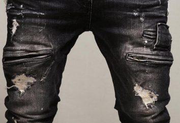 Gli uomini jeans strappati in modo moderno
