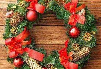 coroa de ramos com as suas mãos de Natal e Ano Novo